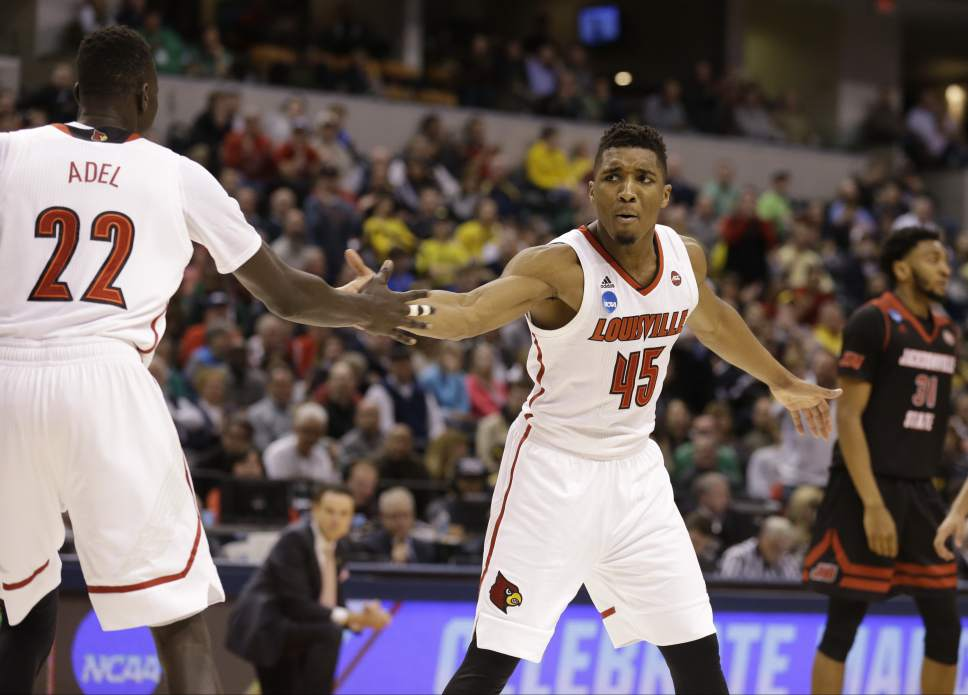 Louisville guard Donovan Mitchell (45) celebrates with Louisville forward Deng Adel (22) during the second half of a first-round game against Jacksonville State in the men's NCAA college basketball tournament in Indianapolis, Friday, March 17, 2017. Louisville defeated Jacksonville State 78-63. (AP Photo/Michael Conroy)