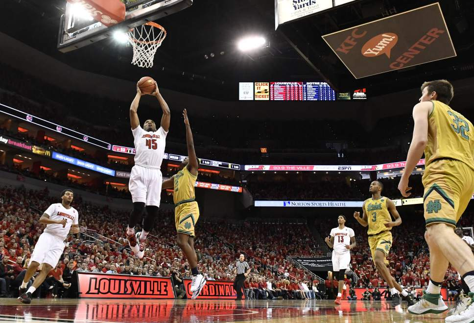 Louisville's Donovan Mitchell (45) dunks over the defense of Notre Dame's Temple Gibbs (2) during the second half of an NCAA college basketball game, Saturday, March 4, 2017, in Louisville, Ky. Louisville won 71-64. (AP Photo/Timothy D. Easley)
