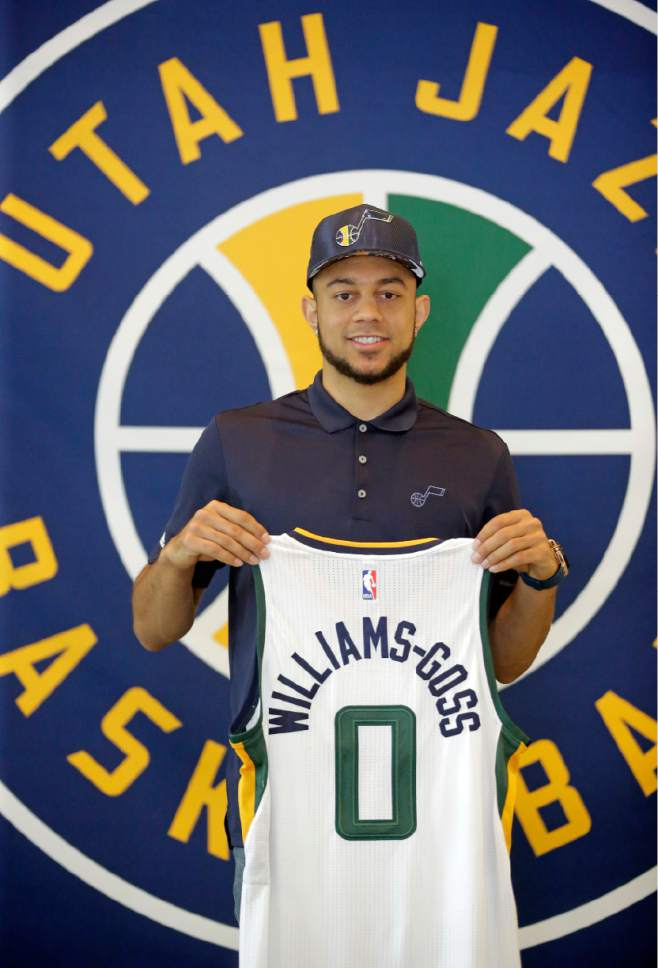 Utah Jazz's Nigel Williams-Goss poses for photos after the Jazz introduced their 2017 NBA Draft picks during a news conference Wednesday, June 28, 2017, in Salt Lake City. (AP Photo/Rick Bowmer)