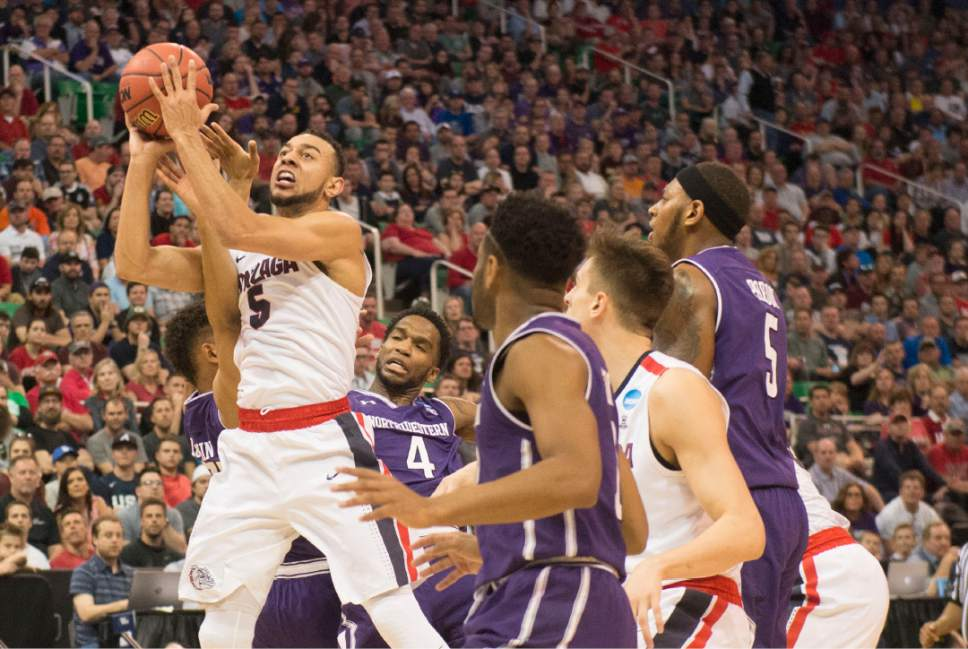 Chris Detrick  |  The Salt Lake Tribune  Gonzaga Bulldogs guard Nigel Williams-Goss (5) drives to the hoop through a number of Northwestern players as the teams face off in the NCAA tournament in Salt Lake City on Saturday, March 18, 2017.