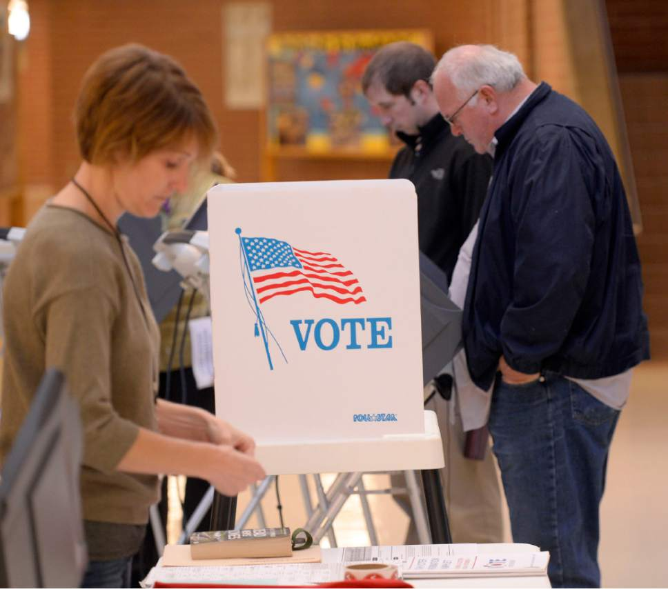 Al Hartmann  |  Tribune file photo Voters cast their ballots at Hawthorne Elementary School in Salt Lake City during the 2014 general election.