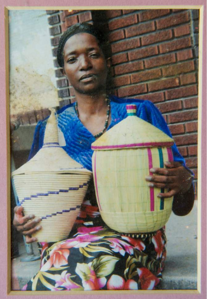 "Photo courtesy of Amandine Akimana.  Amandine Akimana's mother, Goreth Ntahizaniye, pictured with her handmade pots taken in 2010.  ""Even though I wanted the full college experience, it's okay,"" said  Amandine Akimana, 19, whose dedication as guardian to her brothers and sisters requires that she commute to college and keep up her 40-hour-a-week job. The East High graduate, whose family escaped the civil war in Burundi, shares legal custody of her four younger siblings with her older brother after her parents died shortly after arriving in the United States. Akimana will pursue a law degree."