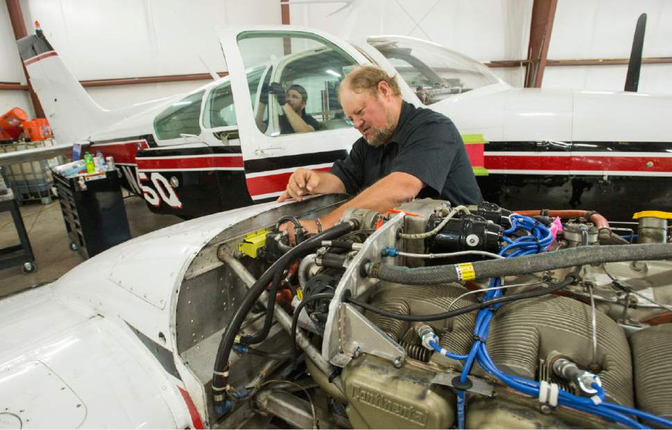 Rick Egan  |  The Salt Lake Tribune  Goose Bistline works on a Beechcraft Baron, twin-engined piston aircraft, that will be used in the Southern Utah University Flight School. Wednesday, June 14, 2017.