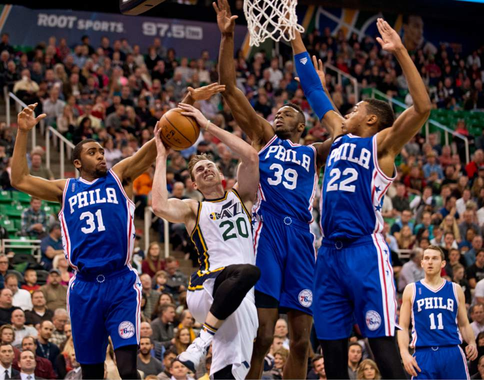 Lennie Mahler  |  The Salt Lake Tribune  Jazz guard Gordon Hayward draws a foul as he is guarded by Hollis Thompson, Jerami Grant and Richaun Holmes in the first half of a game against the Philadelphia 76ers at Vivint Smart Home Arena, Monday, Dec. 28, 2015.