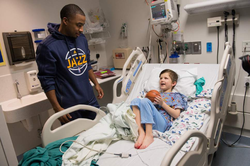 Leah Hogsten  |  The Salt Lake Tribune Utah Jazz assistant coach Johnnie Bryant visits with Harrison O'Toole, 6, who admitted he styles his hair after Jazz player Gordon Hayward. Players from the Utah Jazz, Salt Lake City Stars players and coaches, Jazz Dancers, Jazz Bear and members of the Wheelin' Jazz  visited Primary Children's Hospital, Thursday, Dec. 15, 2016. The annual Christmas hospital visits are part of the NBA Cares Season of Giving and allow the organization to deliver holiday cheer to patients and their families.