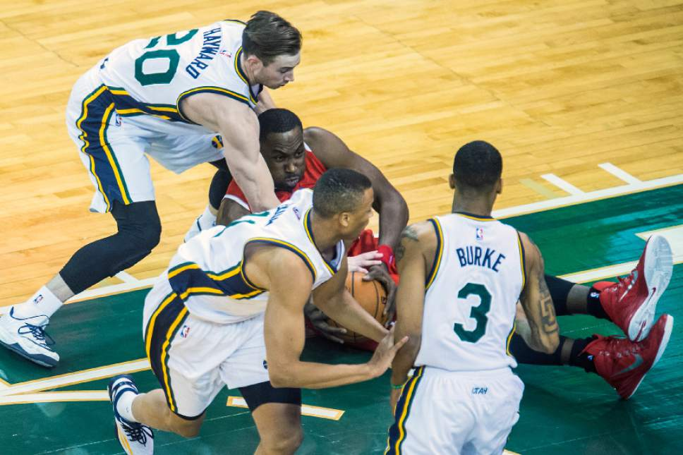 Chris Detrick  |  The Salt Lake Tribune Utah Jazz forward Gordon Hayward (20) and Atlanta Hawks forward Elton Brand (7) go for the ball during the game at EnergySolutions Arena Friday January 2, 2015.  Atlanta is winning the game 57-45 at halftime.
