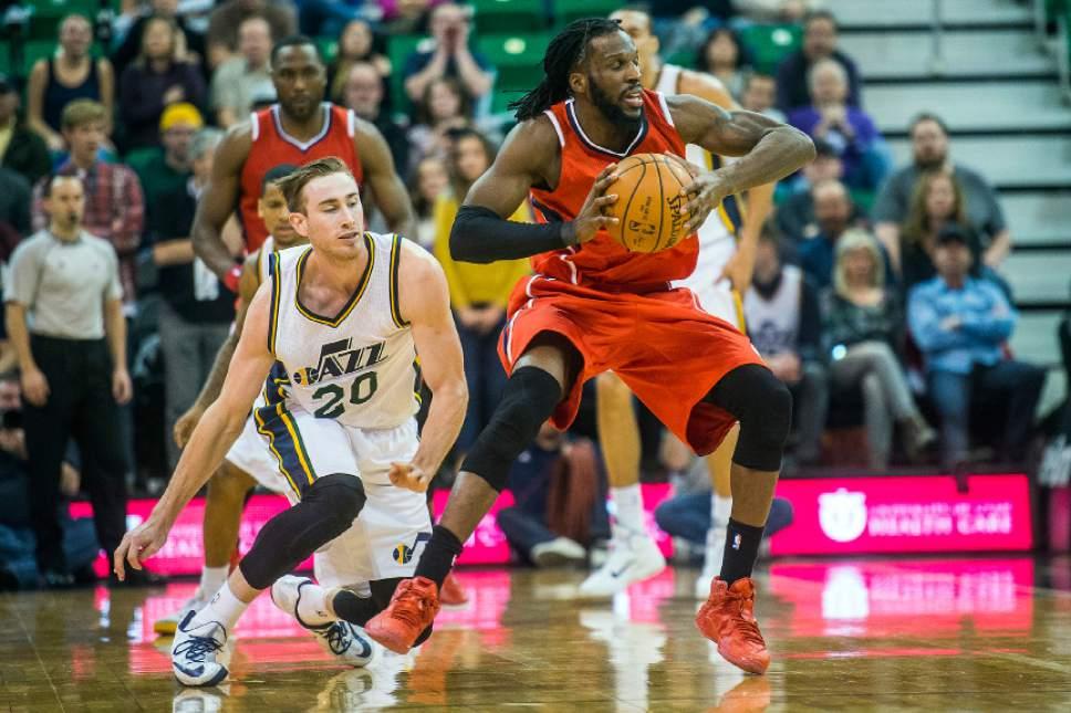 Chris Detrick  |  The Salt Lake Tribune Utah Jazz forward Gordon Hayward (20) and Atlanta Hawks forward DeMarre Carroll (5) during the game at EnergySolutions Arena Friday January 2, 2015.  Atlanta won the game 98-92.