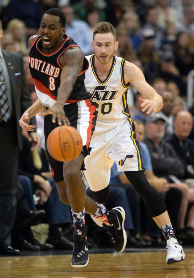 Steve Griffin  |  The Salt Lake Tribune  Utah Jazz forward Gordon Hayward (20) gets called for a break away foul on Portland Trail Blazers forward Al-Farouq Aminu (8) during the Utah Jazz versus Portland Trailblazers NBA basketball game at Vivint Smart Home Arena in Salt Lake City, Wednesday, November 4, 2015.
