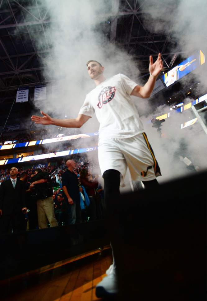 Steve Griffin  |  The Salt Lake Tribune  Utah Jazz forward Gordon Hayward (20) walks through a smoke screen as he is introduced during the home opener for the Utah Jazz as they play the Portland Trailblazers NBA basketball game at Vivint Smart Home Arena in Salt Lake City, Wednesday, November 4, 2015.