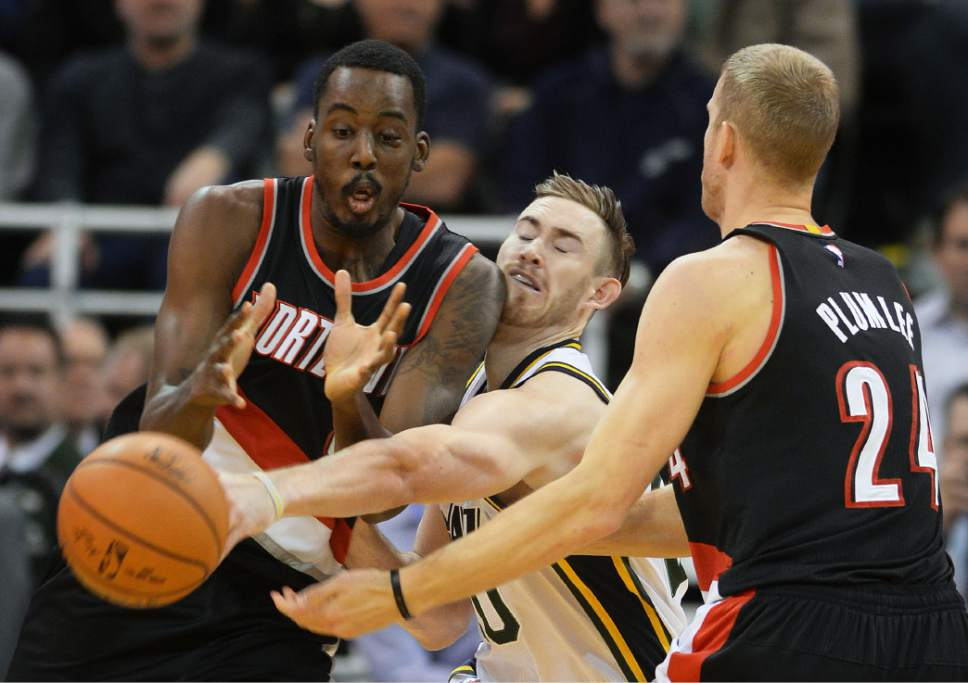 Steve Griffin  |  The Salt Lake Tribune  Utah Jazz forward Gordon Hayward (20) reaches between Portland Trail Blazers forward Al-Farouq Aminu (8) and Portland Trail Blazers center Mason Plumlee (24) as he knocks the ball away during the Utah Jazz versus Portland Trailblazers NBA basketball game at Vivint Smart Home Arena in Salt Lake City, Wednesday, November 4, 2015.