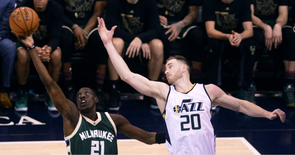 Steve Griffin / The Salt Lake Tribune  Milwaukee Bucks guard Tony Snell (21) grabs a rebound over the outstretched arms of Utah Jazz forward Gordon Hayward (20) during NBA game at Vivint Smart Home Arena in Salt Lake City Wednesday February 1, 2017.