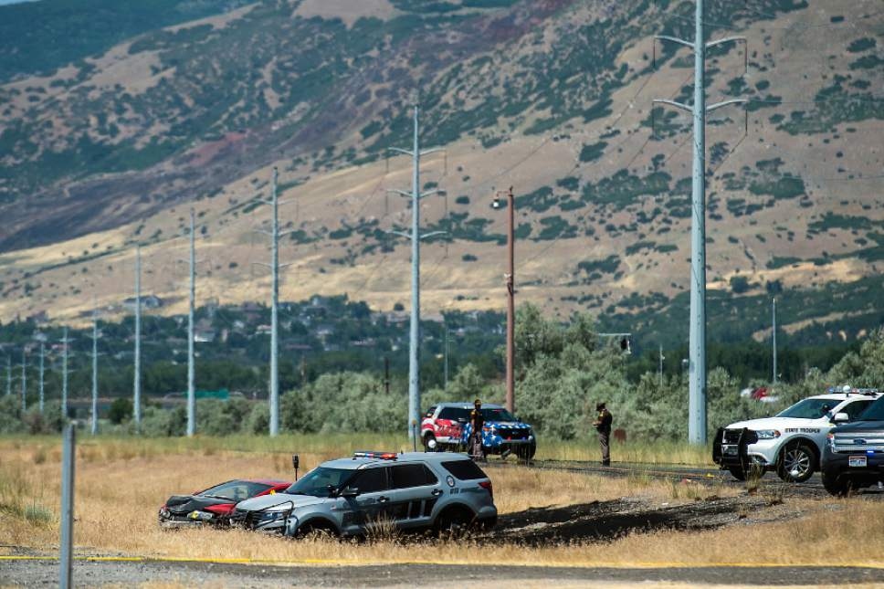Chris Detrick  |  The Salt Lake Tribune The scene of an officer-involved shooting on Legacy Parkway near Glover Lane in Centerville Tuesday, July 4, 2017.