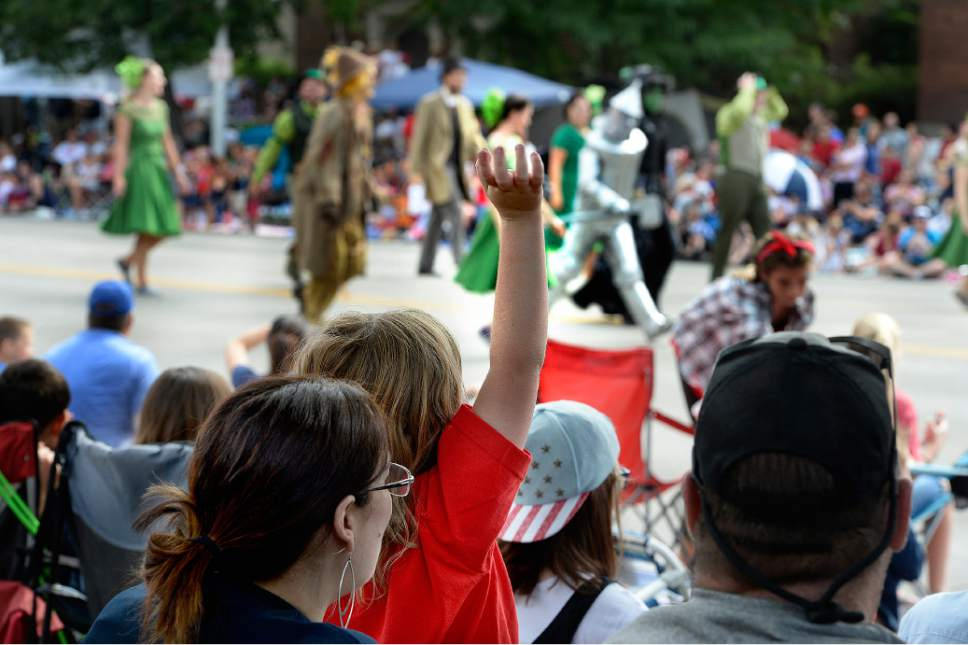 "Scott Sommerdorf   |   Tribune file photo A little girl waves at characters dressed as the cast from ""The Wizard of Oz"" as they run by during the Fourth of July Parade in Provo, Saturday, July 4, 2015."