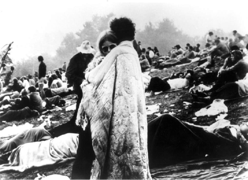 Associated Press | File photo    A couple embraces during the historic Woodstock concert in 1969.  A new study finds that older Americans engaged in extramarital sex in 2016 at a higher than their younger counterparts -- a trend  University of Utah researchers attribute in part to the 1970s-era Sexual Revolution. (AP-Photo)