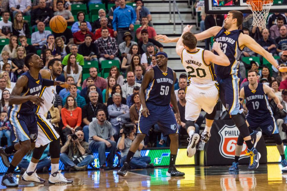 Chris Detrick  |  The Salt Lake Tribune Utah Jazz forward Gordon Hayward (20) and Memphis Grizzlies center Marc Gasol (33) go after the ball during the game at EnergySolutions Arena Friday April 10, 2015. Memphis Grizzlies won the game 89-88.