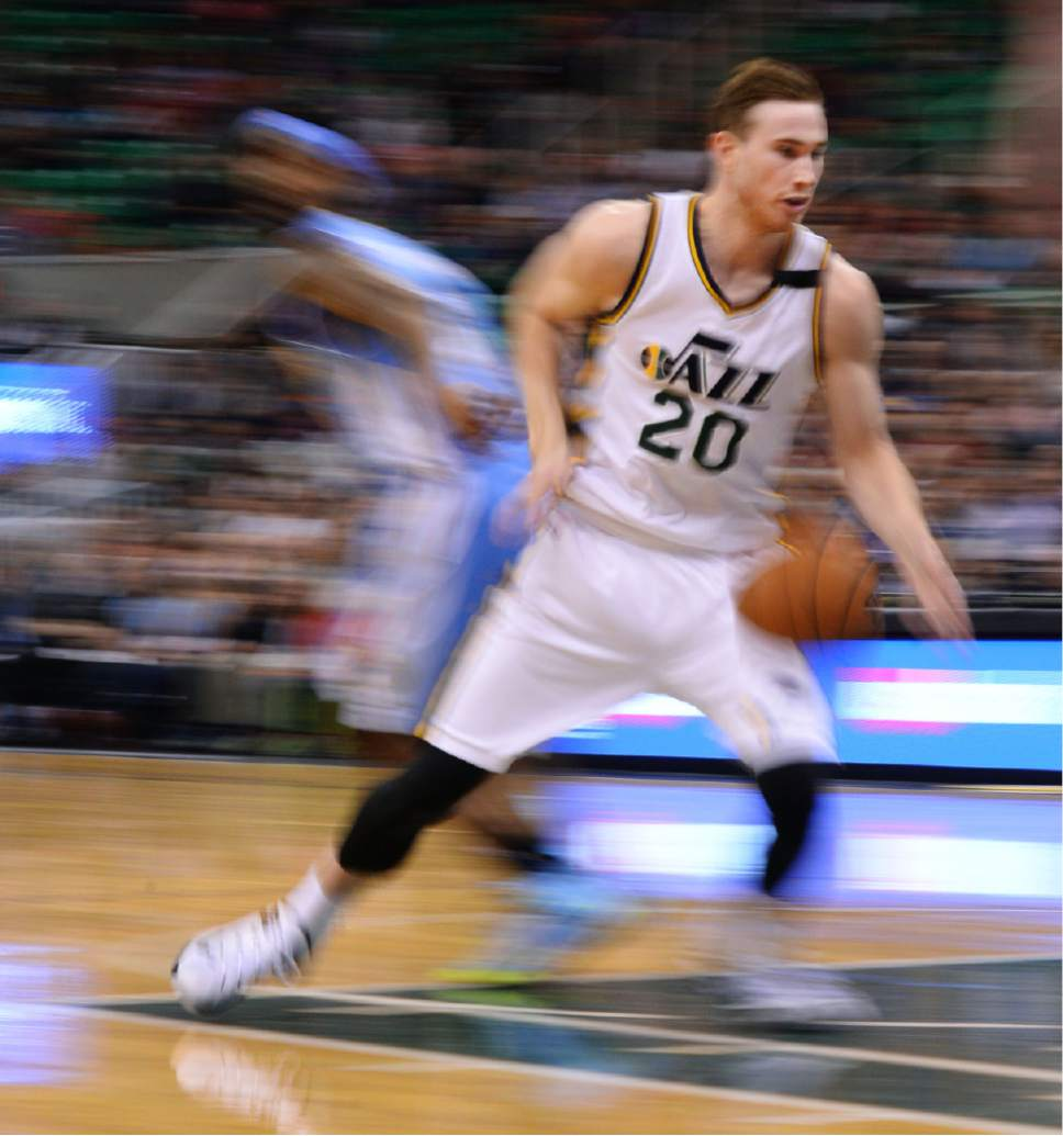Steve Griffin  |  The Salt Lake Tribune  Utah Jazz forward Gordon Hayward (20) drives into the lane during second half action in the Jazz versus Nuggets NBA game at EnergySolutions Arena in Salt Lake City, Wednesday, April 1, 2015.