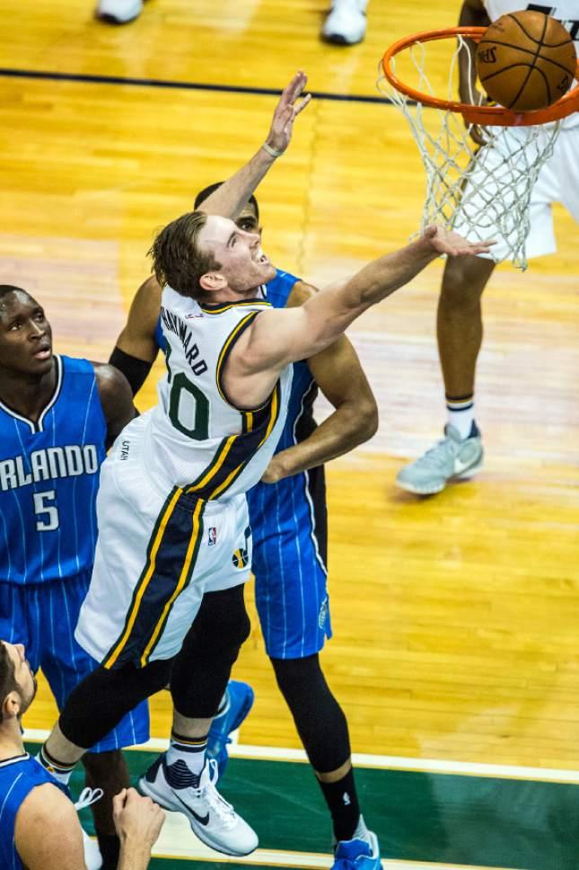 Chris Detrick  |  The Salt Lake Tribune Utah Jazz forward Gordon Hayward (20) shoots past Orlando Magic guard Victor Oladipo (5) and Orlando Magic forward Tobias Harris (12) during the game at Vivint Smart Home Arena Thursday December 3, 2015.
