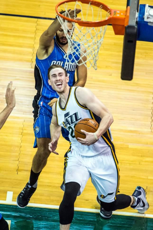 Chris Detrick  |  The Salt Lake Tribune Utah Jazz forward Gordon Hayward (20) is fouled by Orlando Magic forward Evan Fournier (10) during the game at Vivint Smart Home Arena Thursday December 3, 2015.