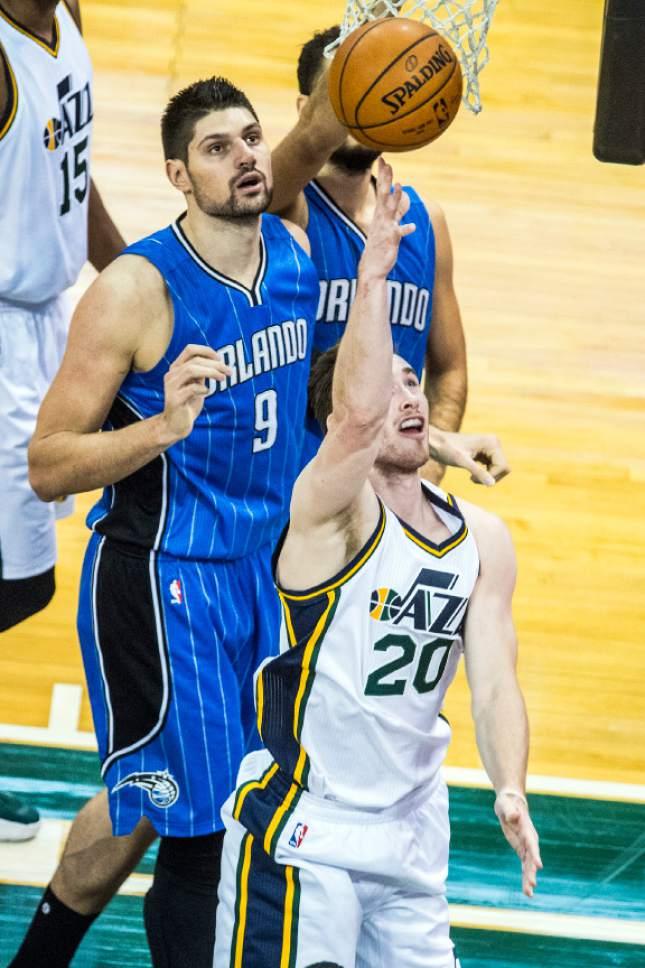Chris Detrick  |  The Salt Lake Tribune Utah Jazz forward Gordon Hayward (20) shoots past Orlando Magic center Nikola Vucevic (9) during the game at Vivint Smart Home Arena Thursday December 3, 2015.