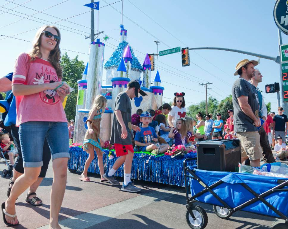 Michael Mangum  |  Special to the Tribune  A parade marches west on Evergreen Ave during an Independence Day celebration on Tuesday, July 4th, 2017 in Millcreek.