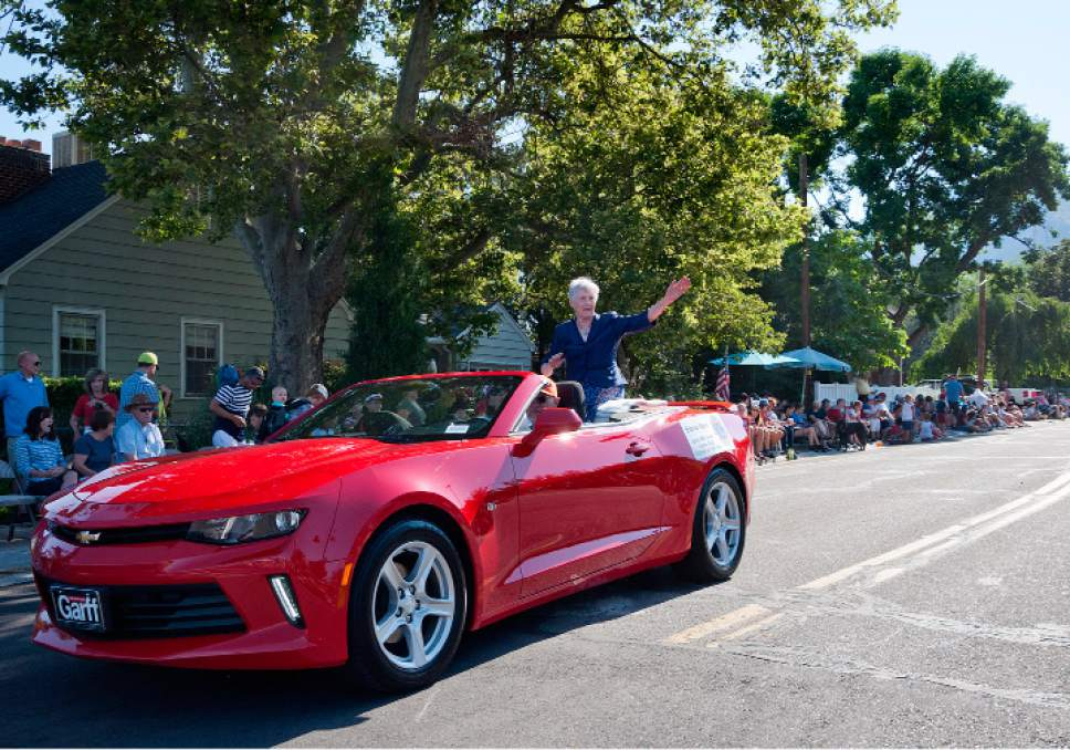 Michael Mangum  |  Special to the Tribune  Elaine Davis, East Mill Creek Lions Club citizen of the year, waves to the crowd during an Independence Day parade on Tuesday, July 4th, 2017 in Millcreek.
