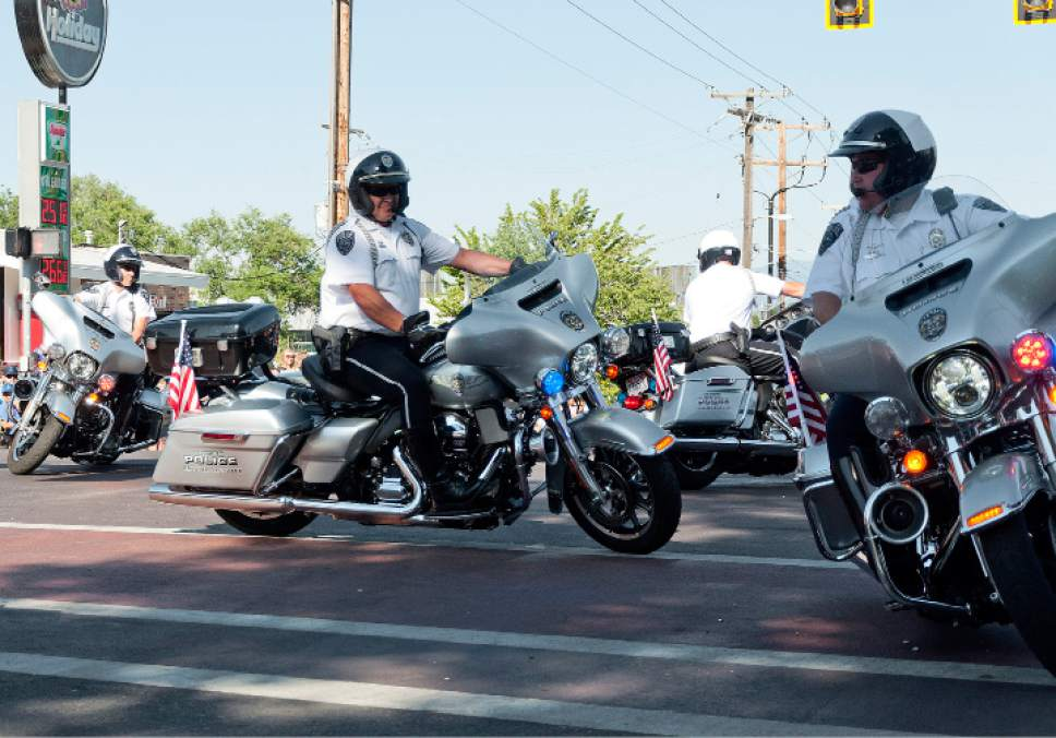 Michael Mangum  |  Special to the Tribune  Unified Police Department officers ride motorcycles in formation during an Independence Day parade on Tuesday, July 4th, 2017 in Millcreek.