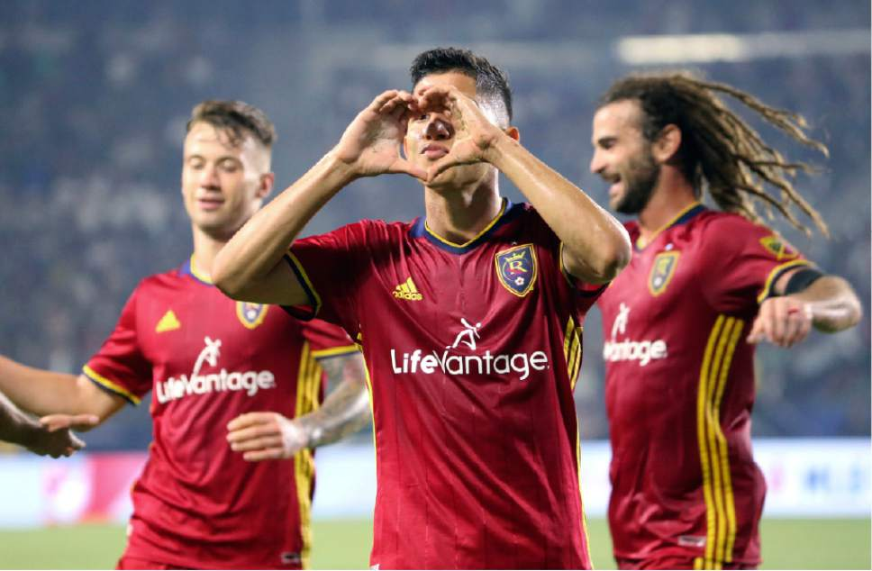 Real Salt Lake forward Jefferson Savarino (7) gestures to a quiet crowd with midfielders Albert Rusnak (11), left, and Kyle Beckerman (5), all of whom scored goals against the LA Galaxy, in the second half of an MLS soccer match in Carson, Calif., Tuesday, July 4, 2017. Real Salt Lake won, 6-2. (AP Photo/Reed Saxon)