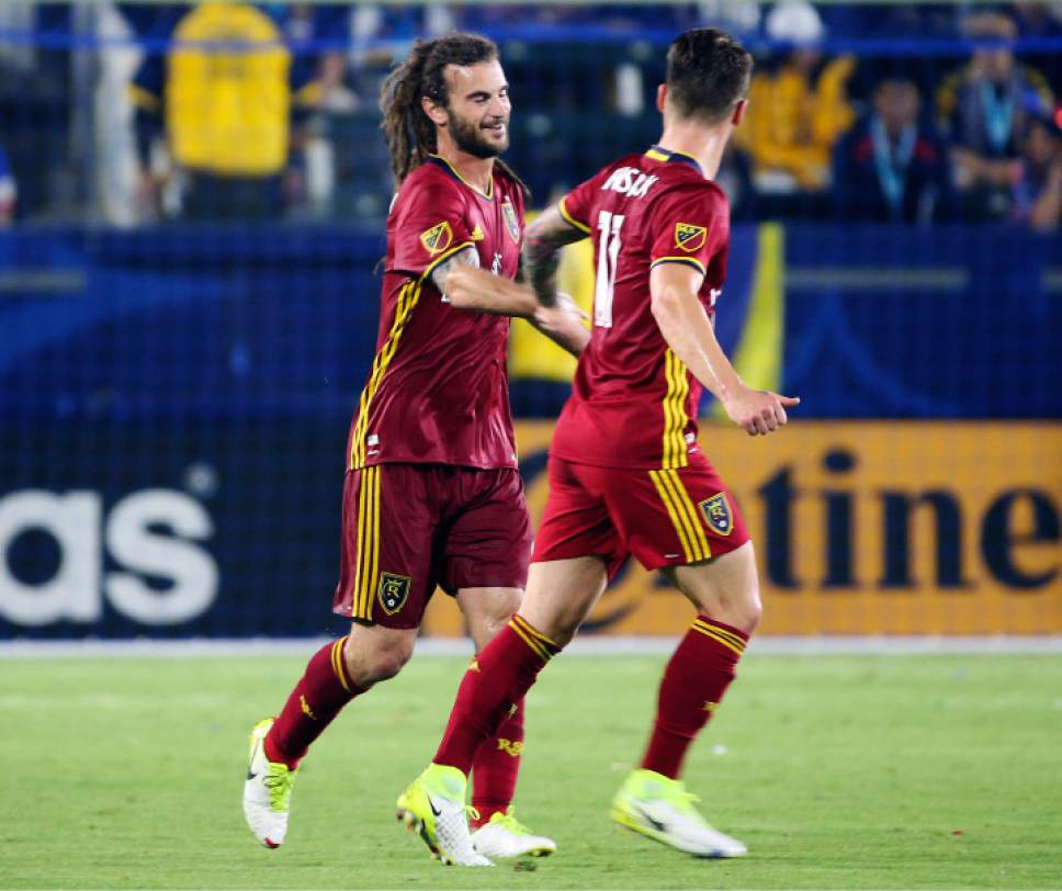 Real Salt Lake midfielder Kyle Beckerman (5), left, and midfielder Albert Rusnak (11) celebrate after Beckerman's goal against the LA Galaxy in the first half of an MLS soccer match in Carson, Calif., Tuesday, July 4, 2017. Rusnak has also scored in the first half. (AP Photo/Reed Saxon)