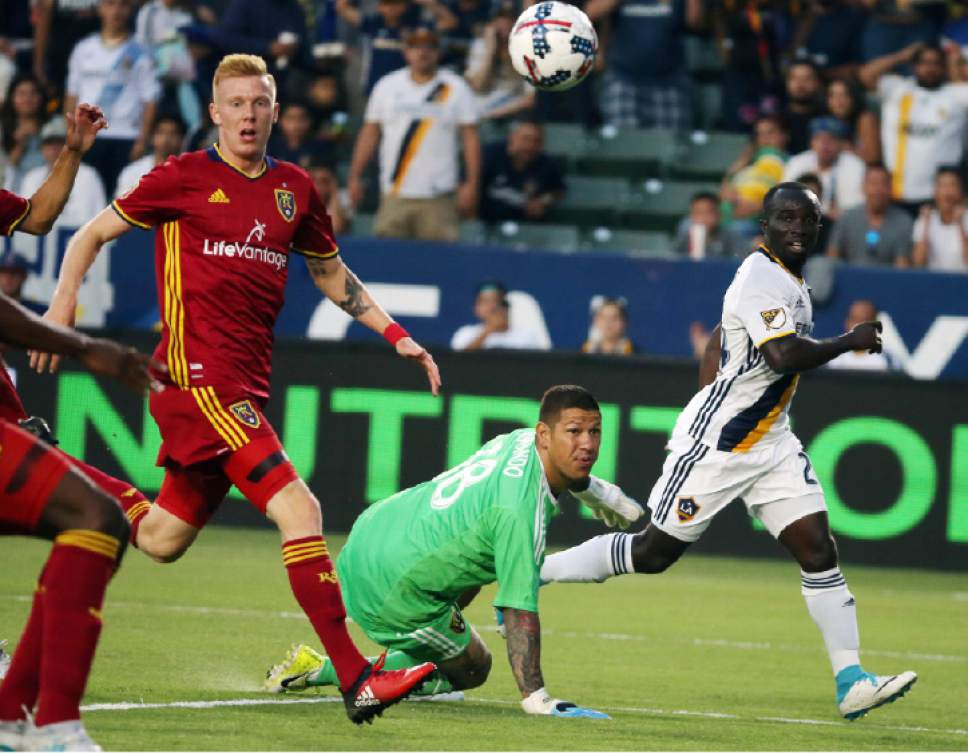 Reed Saxon  |  The Associated Press Real Salt Lake defender Justen Glad, from left, RSL goalkeeper Nick Rimando and L.A. Galaxy midfielder Emmanuel Boateng battle for the ball during the first half Tuesday in Carson, Calif.