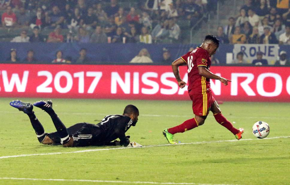 Real Salt Lake forward Joao Plata (10) scores past LA Galaxy goalkeeper Clement Diop (31) in the second half of an MLS soccer match in Carson, Calif., Tuesday, July 4, 2017. Real Salt Lake won, 6-2. (AP Photo/Reed Saxon)
