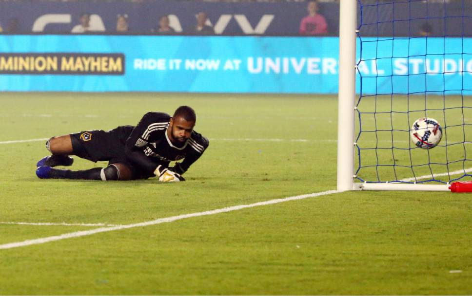 LA Galaxy goalkeeper Clement Diop (31) watches a goal by Real Salt Lake forward Jefferson Savarino go into the net in the second half of an MLS soccer match in Carson, Calif., Tuesday, July 4, 2017. Real Salt Lake won, 6-2. (AP Photo/Reed Saxon)