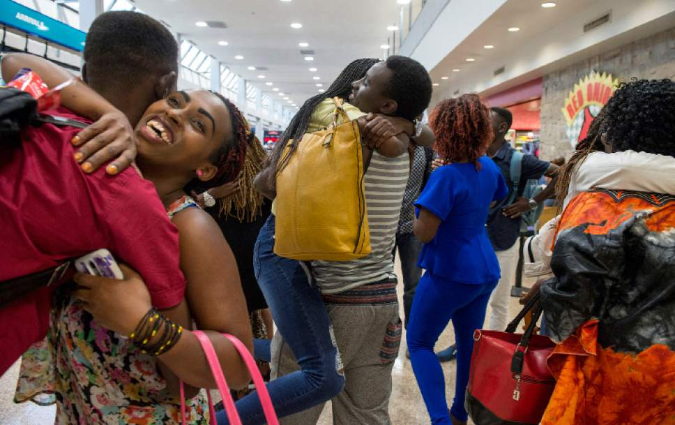 Leah Hogsten  |  The Salt Lake Tribune Gustav Nyangabo hugs his sister Evelyne Gaju (center) moments after the arrival of Gaju and Nyangabo's mother and four other siblings from the Democratic Republic of Congo. The Salt Lake City office of the International Rescue Committee welcomed the last refugee family to Utah on Thursday,  July 6, 2017, before President Donald Trump's 120-day ban on refugees goes into effect.
