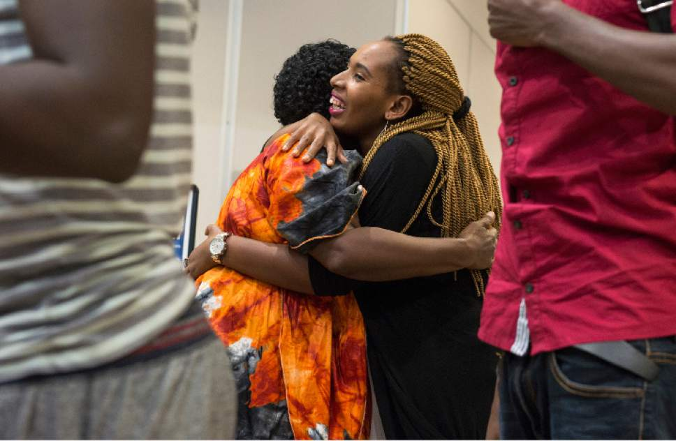 Leah Hogsten  |  The Salt Lake Tribune   Aimee Ingabire, right, hugs her mother Jullien Mukantagara, moments after her arrival in Salt Lake City from the Democratic Republic of Congo where Mukantagara was reunited with all of her children. The Salt Lake City office of the International Rescue Committee welcomed the last refugee family to Utah on Thursday, July 6, 2017, before President Donald Trump's 120-day ban on refugees goes into effect.