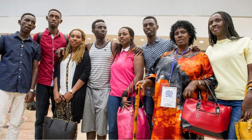 Leah Hogsten  |  The Salt Lake Tribune   l-r Kayiranga Jules, Patrick Byusa, Aimee Ingabire, Gustav Nyangabo, Adeline Uwicyeza, Makuza Innocent, Jullien Mukantagara and Evelyne Gaju, a family from the Democratic Republic of Congo, were reunited at the Salt Lake International Airport. The Salt Lake City office of the International Rescue Committee welcomed the last refugee family to Utah on Thursday,  July 6, 2017, before President Donald Trump's 120-day ban on refugees goes into effect.