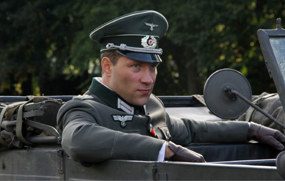 """Jai Courtney plays Capt. Stefan Brandt, a German officer assigned to guard Kaiser Wilhelm II, and finds himself torn between duty and love in the World War II drama """"The Exception."""" Courtesy A24 Films"""