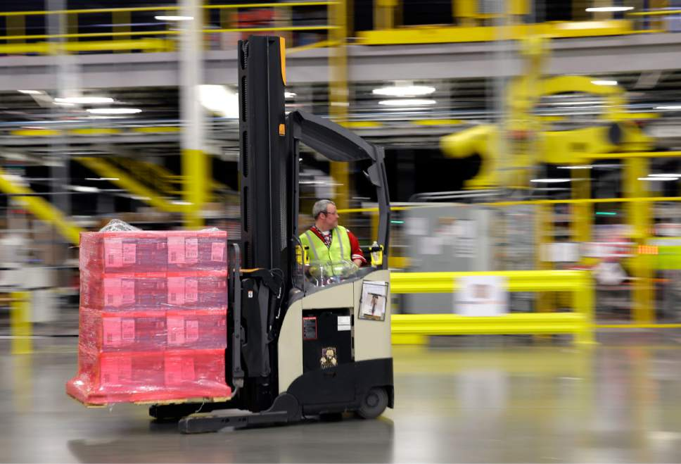 (Ted S. Warren | AP file photo)   In this Feb. 13, 2015, file photo, a forklift operator moves a pallet of goods at an Amazon.com fulfillment center in DuPont, Wash. Amazon intends to open a fulfillment center in Salt Lake City that is expected to provide roughly 1,500 jobs.