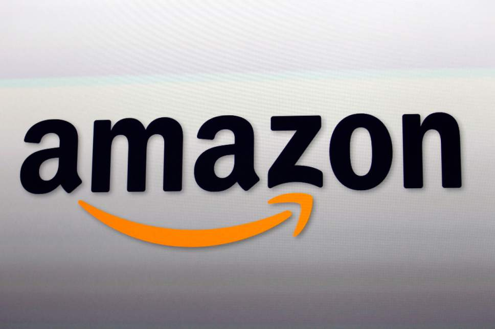 FILE - This Sept. 6, 2012, file photo shows the Amazon logo in Santa Monica, Calif. Amazon.com Inc. reports financial earnings Thursday, April 27, 2017. (AP Photo/Reed Saxon, File)