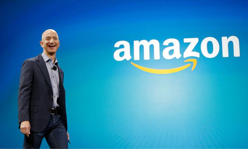 FILE - In this June 16, 2014, file photo, Amazon CEO Jeff Bezos walks onstage for the launch of the new Amazon Fire Phone, in Seattle. Technology leaders are about to come face-to-face with President-elect Donald Trump after fiercely opposing his candidacy, fearful that he would stifle innovation, curb the hiring of computer-savvy immigrants and infringe on consumers' digital privacy. On Wednesday, Dec. 14, 2016, Silicon Valley luminaries and other technology leaders are headed to Trump Tower in New York to make their peace, or press their case, with Trump and his advisers. Bezos is one of the CEOs expected to attend. (AP Photo/Ted S. Warren, File)