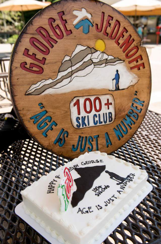 Leah Hogsten  |  The Salt Lake Tribune George Jedenoff was presented with a birthday cake, 100+ yr. old skier patch and a handmade wooden plaque celebrating his achievement. He celebrated his 100th birthday with a couple of ski runs down Chipís Run from the top of the Peruvian Lift at Snowbird on July 5, 2017.