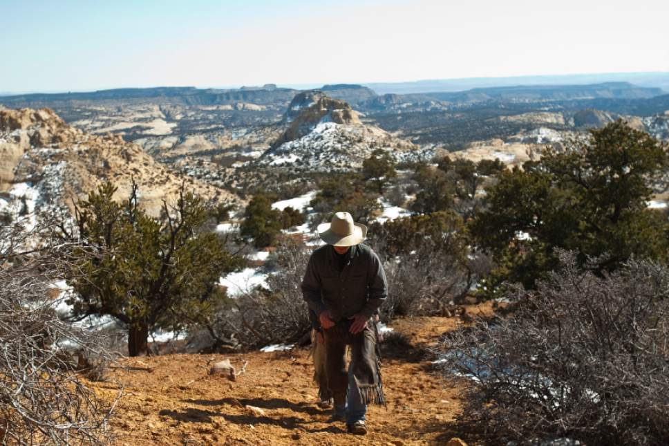 Chris Detrick  |  The Salt Lake Tribune Cowboy Norm Neilson, from Tropic, Utah, walks around Rock Springs Point along the west edge of the Grand Staircase-Escalante National Monument Saturday February 18, 2012.