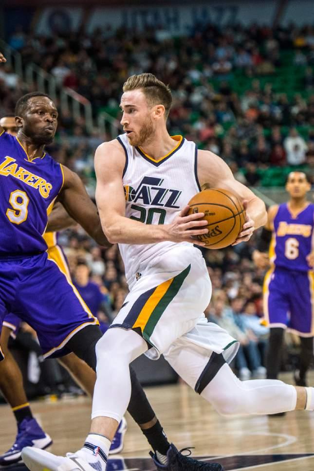 Chris Detrick  |  The Salt Lake Tribune Utah Jazz forward Gordon Hayward (20) runs past Los Angeles Lakers forward Luol Deng (9) during the game at Vivint Smart Home Arena Thursday January 26, 2017.