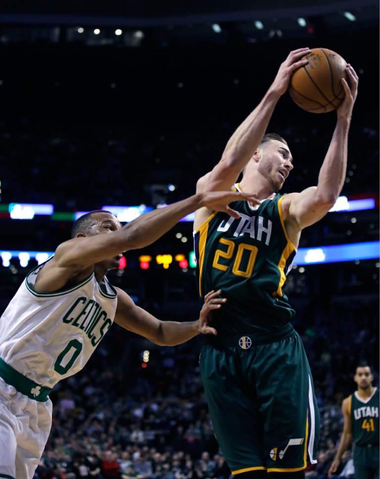 Utah Jazz forward Gordon Hayward (20) hauls down a rebound against Boston Celtics guard Avery Bradley (0) during the first quarter of an NBA basketball game in Boston, Tuesday, Jan. 3, 2017. (AP Photo/Charles Krupa)