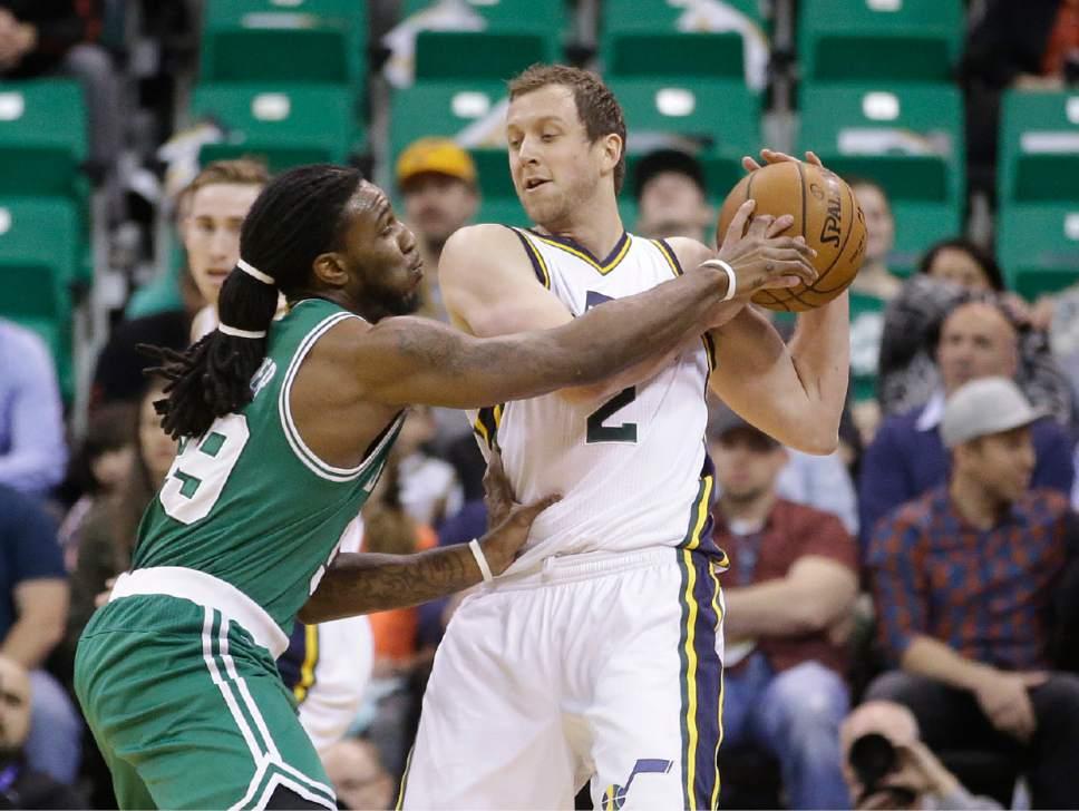 Boston Celtics forward Jae Crowder (99) defends against Utah Jazz forward Joe Ingles (2) in the first quarter during an NBA basketball game Monday, Jan. 26, 2015, in Salt Lake City.  (AP Photo/Rick Bowmer)