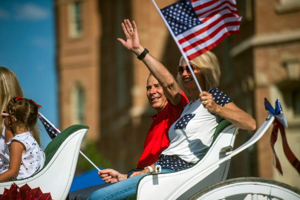 Chris Detrick  |  The Salt Lake Tribune Provo Mayor John Curtis and his family wave to the crowd during the annual Freedom Festival Grand Parade in downtown Provo Tuesday, July 4, 2017.