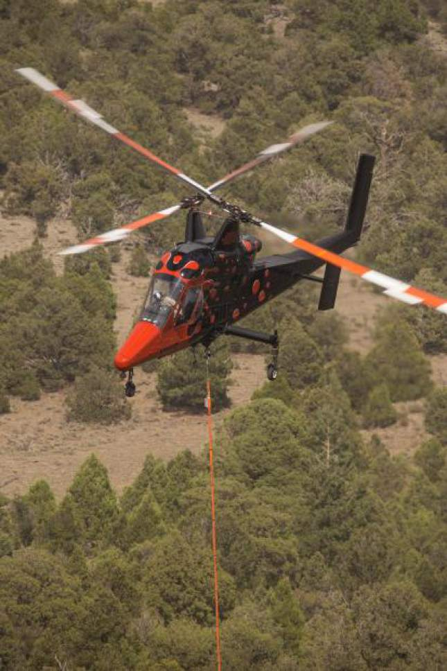 Photo courtesy of the Interagency Fire Center  Firefighters strengthened breaks and lines Friday ahead of what was expected to be a gusty, hot and dry weekend on the nearly 71,000-acre Brian Head Fire in southern Utah.