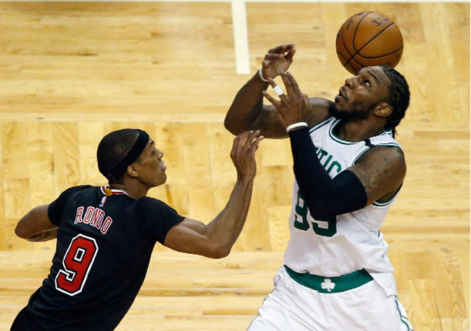 Chicago Bulls' Rajon Rondo (9) and Boston Celtics' Jae Crowder (99) battle for a loose ball during the third quarter of a first-round NBA playoff basketball game, Sunday, April 16, 2017, in Boston. (AP Photo/Michael Dwyer)