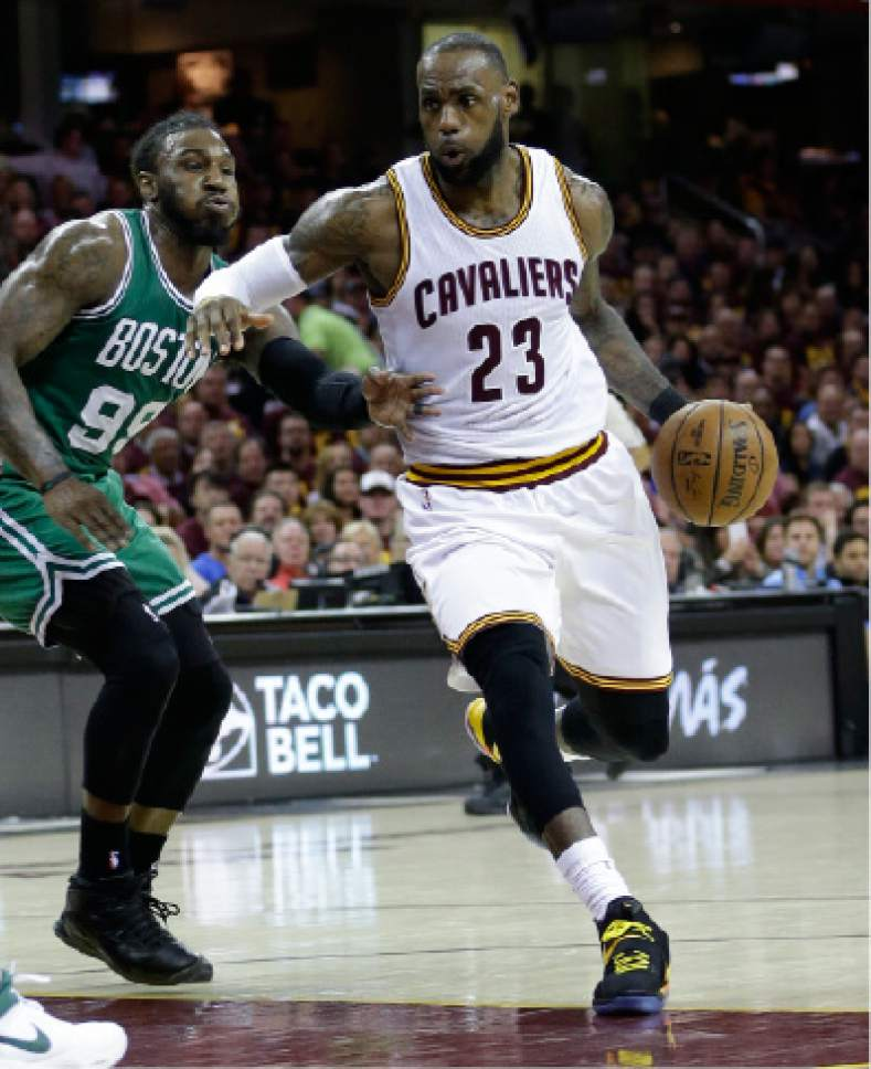 Cleveland Cavaliers' Kyrie Irving (2)3 drives on Boston Celtics' Jae Crowder (99) during the second half of Game 3 of the NBA basketball Eastern Conference finals, Sunday, May 21, 2017, in Cleveland. (AP Photo/Tony Dejak)
