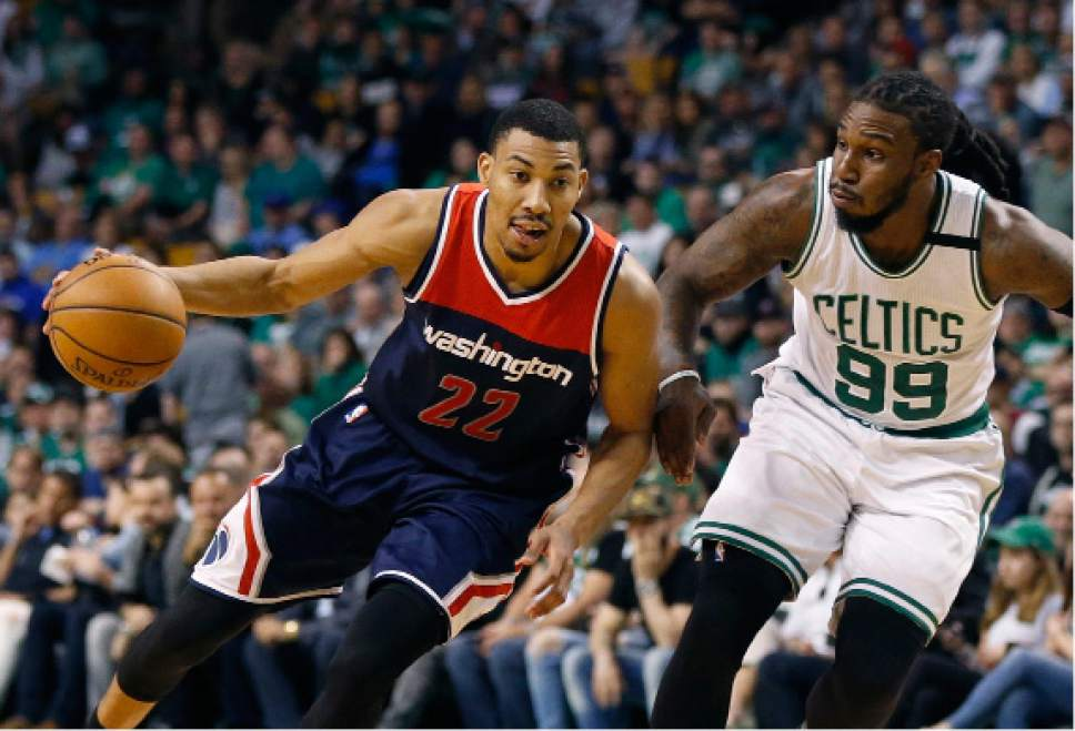 FILE - In this April 30, 2017, file photo, Washington Wizards' Otto Porter Jr. (22) drives past Boston Celtics' Jae Crowder (99) during the third quarter of a second-round NBA playoff series basketball game, in Boston. Following his best NBA season, Otto Porter Jr. has a big offer to join the Brooklyn Nets. Porter has agreed to sign an offer sheet with the Nets, a person with knowledge of the details said. The Wizards plan to match the offer and keep Porter, the person told The Associated Press on Wednesday, July 5, 2017. The person spoke on condition of anonymity because contracts can't be signed until Thursday. (AP Photo/Michael Dwyer, File)