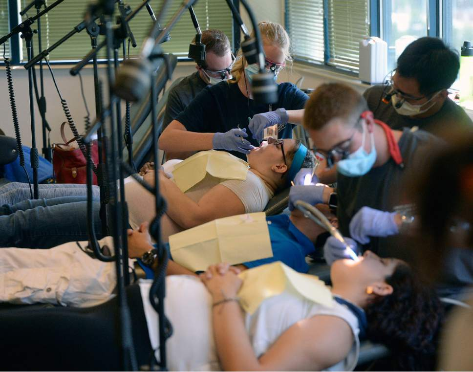 Al Hartmann  |  The Salt Lake Tribune   Dental students give free dental exams on 20 stations at the Junior League CARE Fair in the Horizonte Center in Salt Lake City Friday, July 15, 2016.