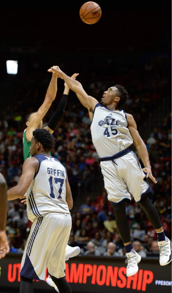 Francisco Kjolseth | The Salt Lake Tribune Donovan Mitchell of the Utah Jazz reaches for a block against the Boston Celtics during the NBA Summer league basketball game at the Huntsman Center, July 6, 2017, in Salt Lake City.